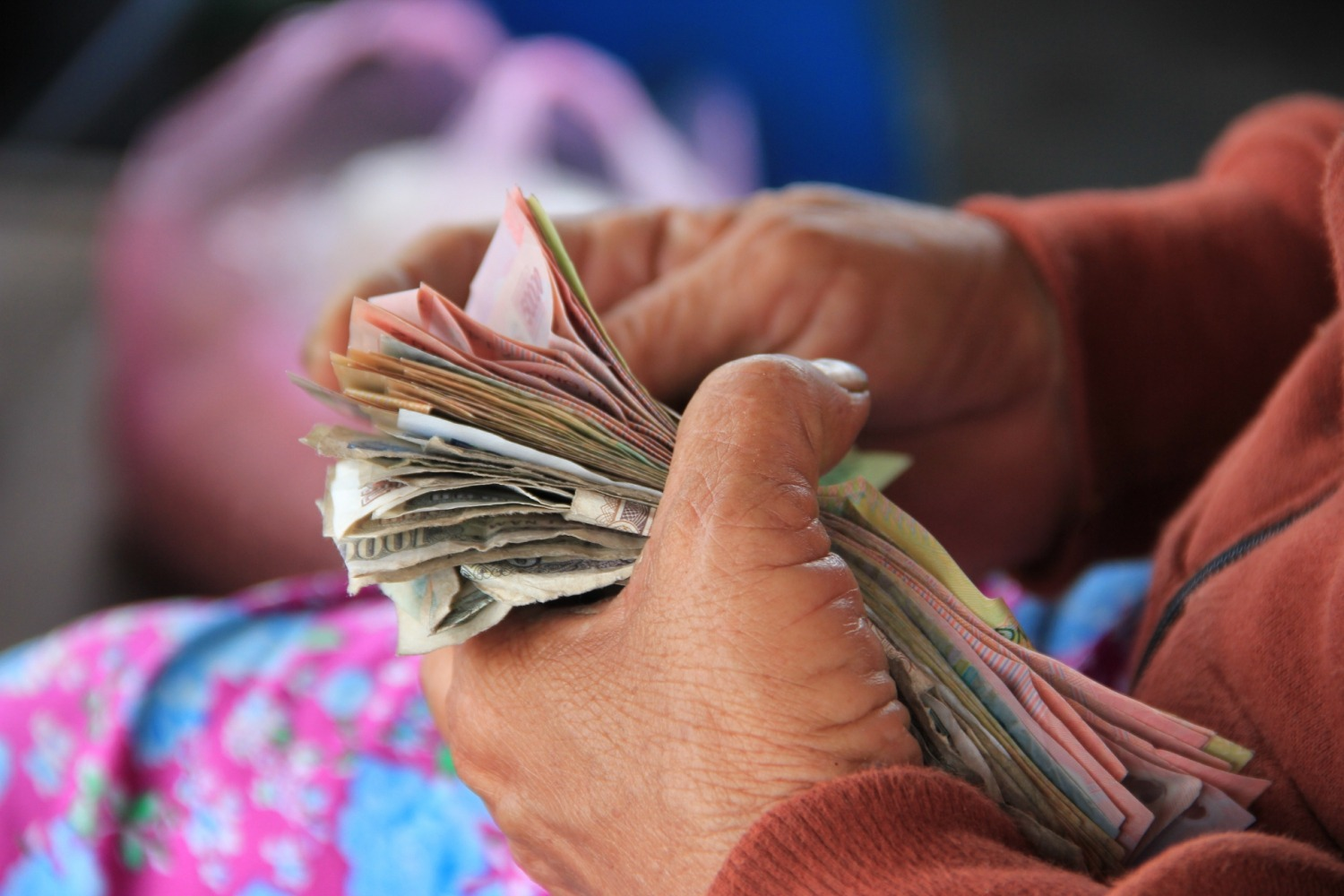 person counting money with their hands